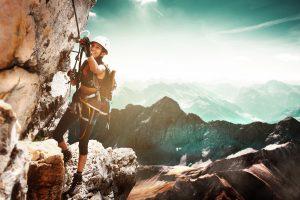 Girl women rock climbing on a Via Ferrata healthy lifestyle pretty scenery