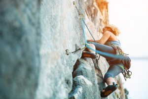girl women rock climbing on vertical flat wall healthy lifestyle livity foods everbar